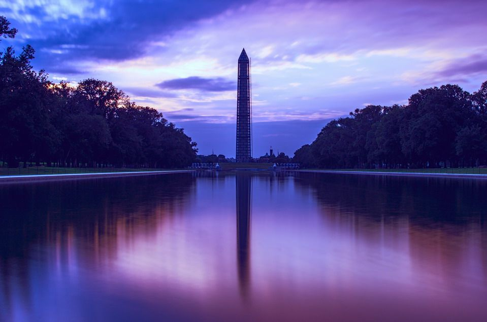 Early morning sunrise of the Washington Monument with blue and purple sky.