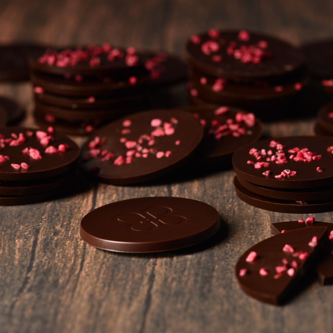 Here S A Small Dose Of Chocolate To Satisfy Your Cravings New Dark Chocolate Circles Sprinkled With Crunchy Blackbe Chocolate Line Chocolate Lovers Chocolate