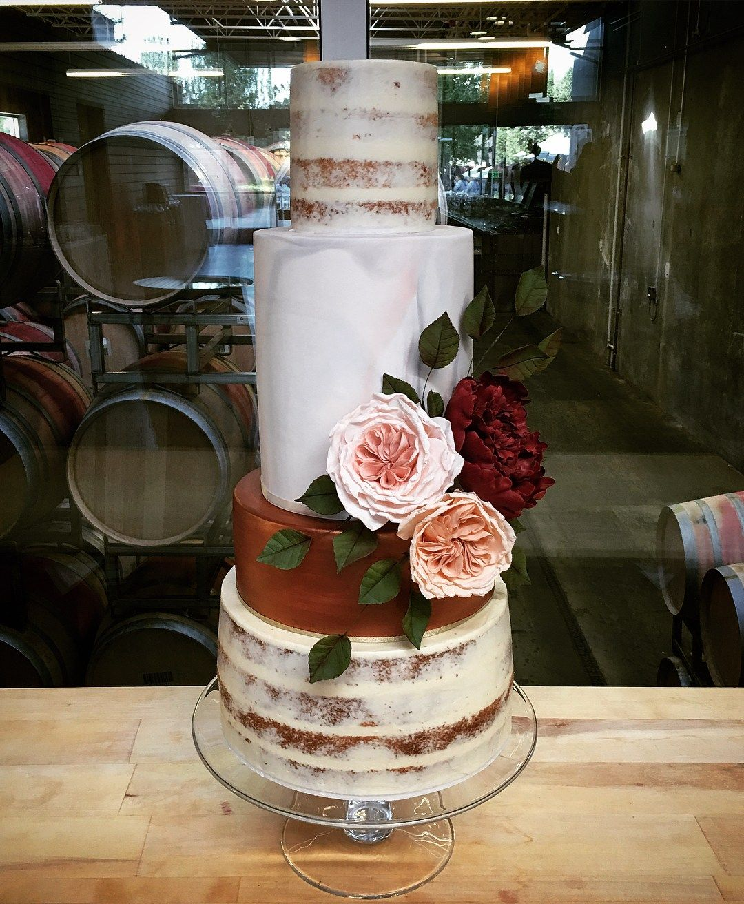 coppery, marbled, nearly-naked combo beauty with her sash of luscious sugar flowers wedding cakes #weddingcake #cake