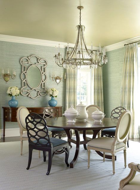 I love everything about this dining room...the grasscloth on the walls, the mirror, pops of turquoise, and the round dining table.