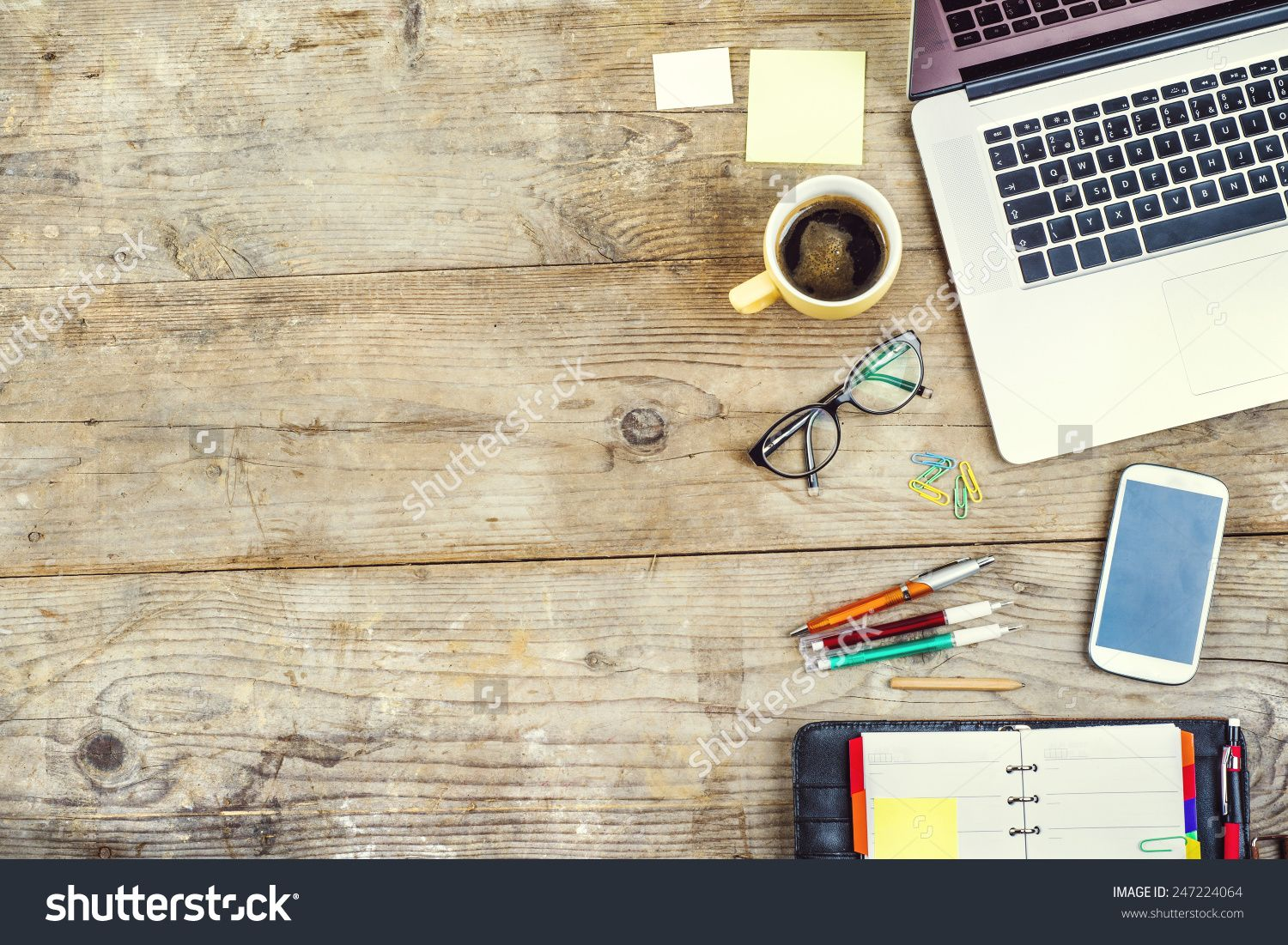 Desktop Mix On A Wooden Office Table Of Supplies And Gadgets Background View From Above