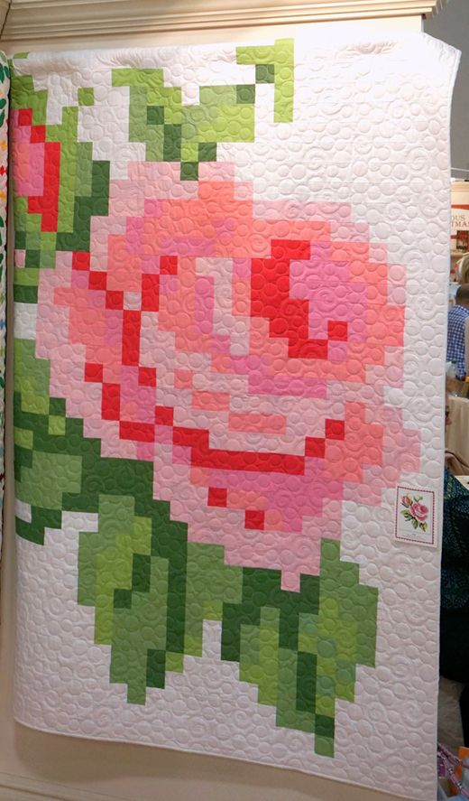 Create a Stunning Rose Quilt with Fabric Squares is part of Flower quilt patterns, Quilt patterns, Pixel quilting, Flower quilts, Rose quilt, Quilt fabric - 2″ squares of solid fabrics  Choose color variations that create depth and shading within the flower and leaves  Quilt from Miss …