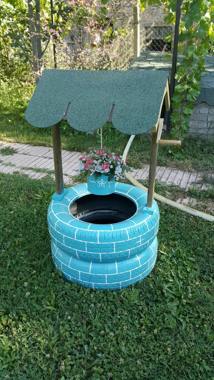 Diy Wishing Well Made From Recycled Tires Tire Planters Diy Planters Diy Wishing Wells
