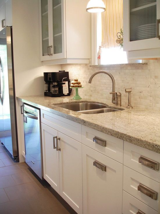 White Shaker Style Cabinets With Modern Brushed Nickel Hardware Kashmir Granite Countertops And Venus Marble Mosaic In Milky Way Backsplash