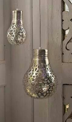 Wrap a doily around a light bulb and spray paint it silver or whatever color you want!