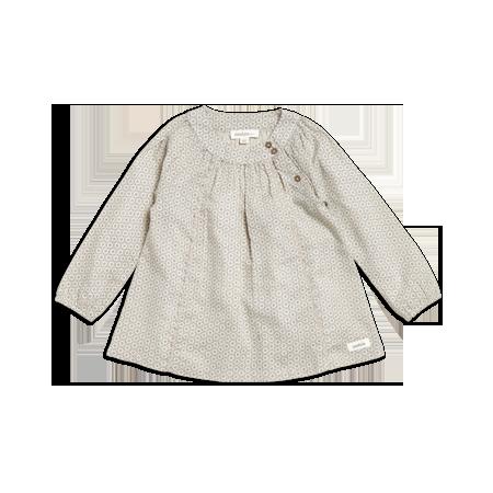 Mönstrad A-linjeformad klänning från Newbie. Dekorativ rynkning fram och bak vid ok. Rundad halsringning med knappar på sidan. Lång ärm med smalt infälld resår i ärmslut. Newbie är en kollektion för de små, där våra bomul...