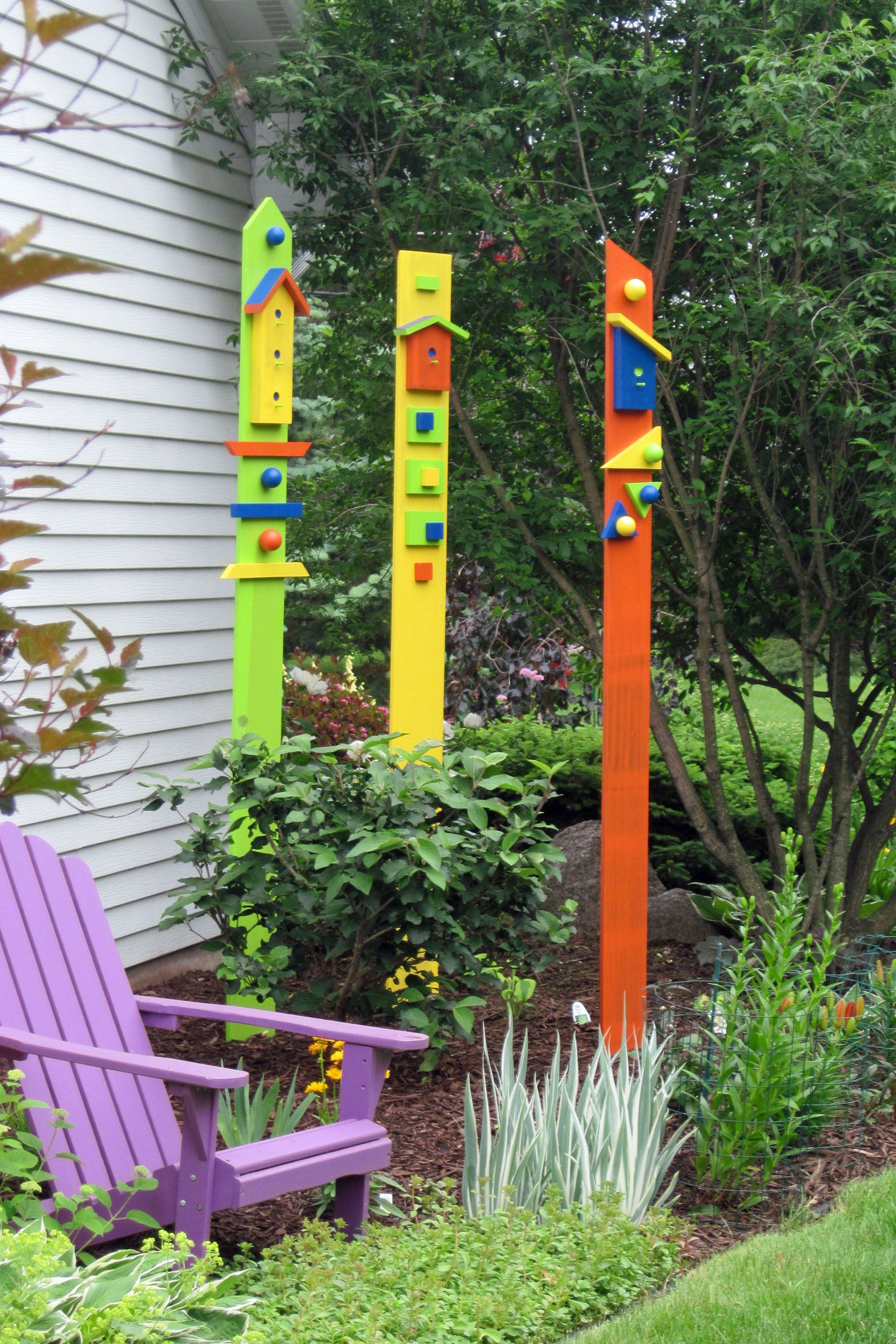 Wooden garden totems created using old fence boards and scrap lumber ...