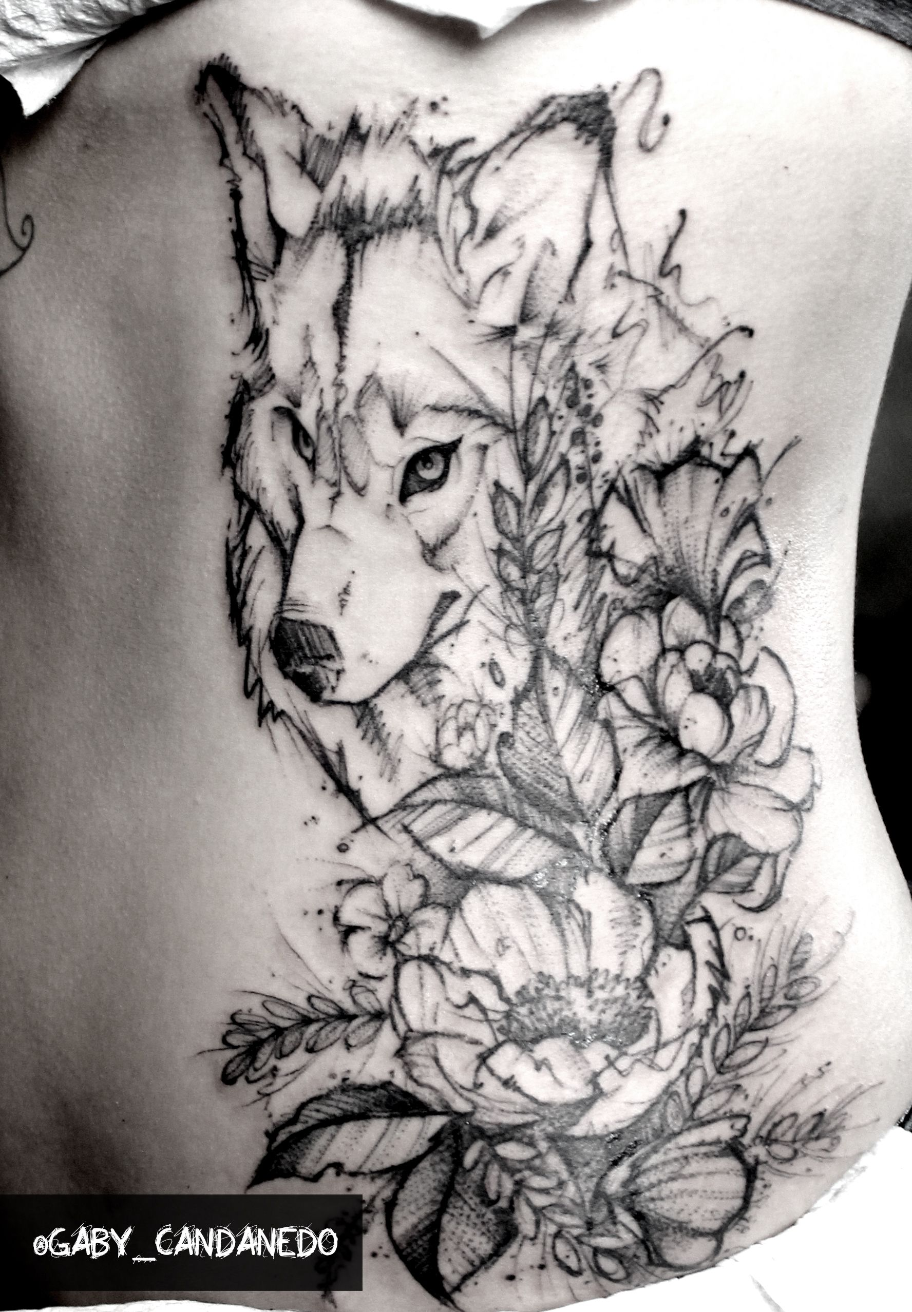 Sketchwork Tattoo Wolf With Flowers On Ribs By Gabycandanedo Wolf