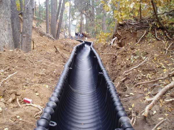 Polyethylene Ditch Liner Is Being Used In Place Of Concrete To Prevent Acequia Erosion And Significant Water Yard Drainage Drainage Solutions Backyard Drainage