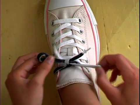 Learn To Tie Your Shoes from Lots To Learn - uses a tree - white laces,  color