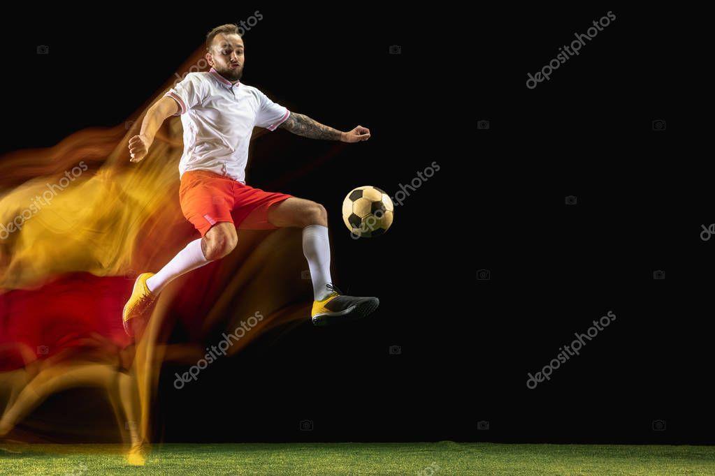 Male Soccer Player Kicking Ball On Dark Background In Mixed Light Stock Sponsored Kicking Ball Player Male Soccer Players Dark Backgrounds Soccer