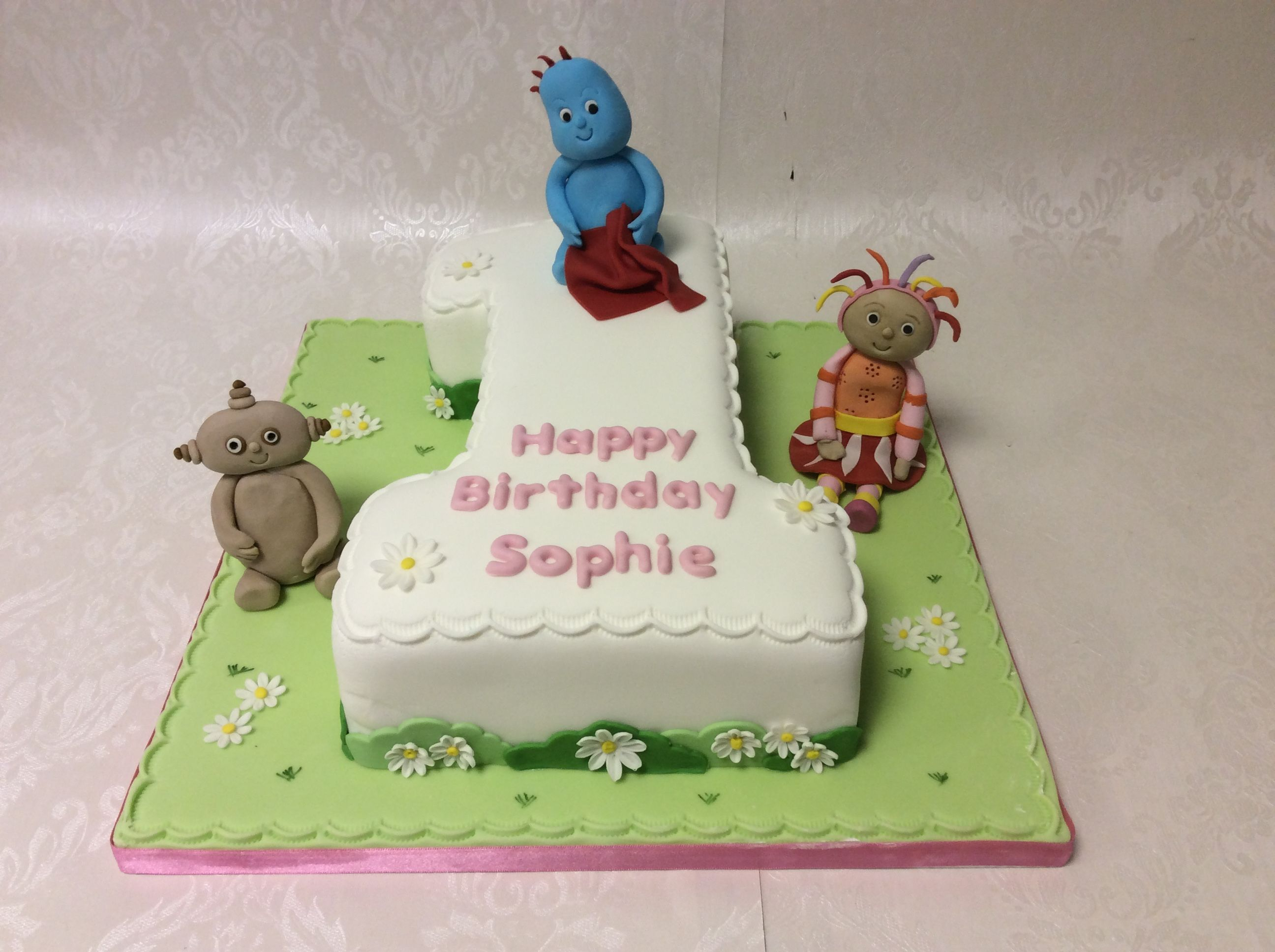 Number 1 shaped cake with 3 main In the Night Garden characters In