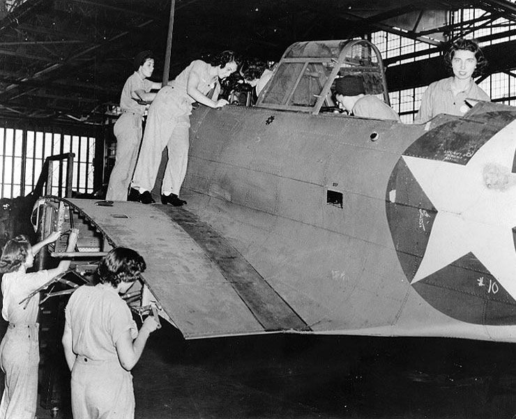 photo waves aviation metalsmiths and aviation machinists mates working on a sbd dauntless aircraft assembly and repair department naval air station