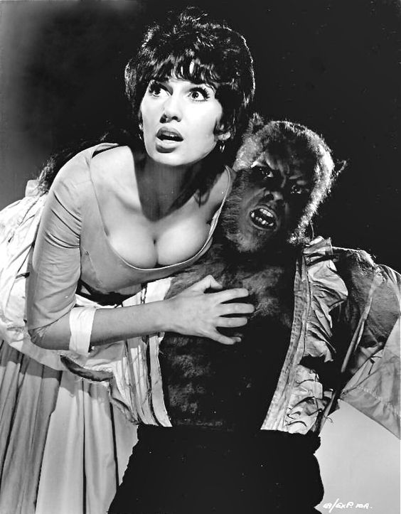 "Yvonne Romain and Oliver Reed in a publicity still for ""The Curse of the Werewolf"""