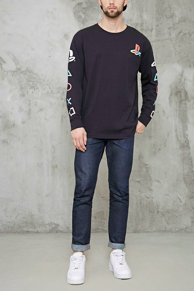 5197ee345 A long-sleeve tee featuring the Playstation logo graphic on the chest and  sleeves, a crew neck, ribbed trim, and long sleeves with Playstation  controller ...