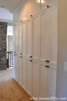 House Of Fifty Built In Storage Hallway Pantry Leading To Kitchen Across From Downstairs Laundry And Bathroom