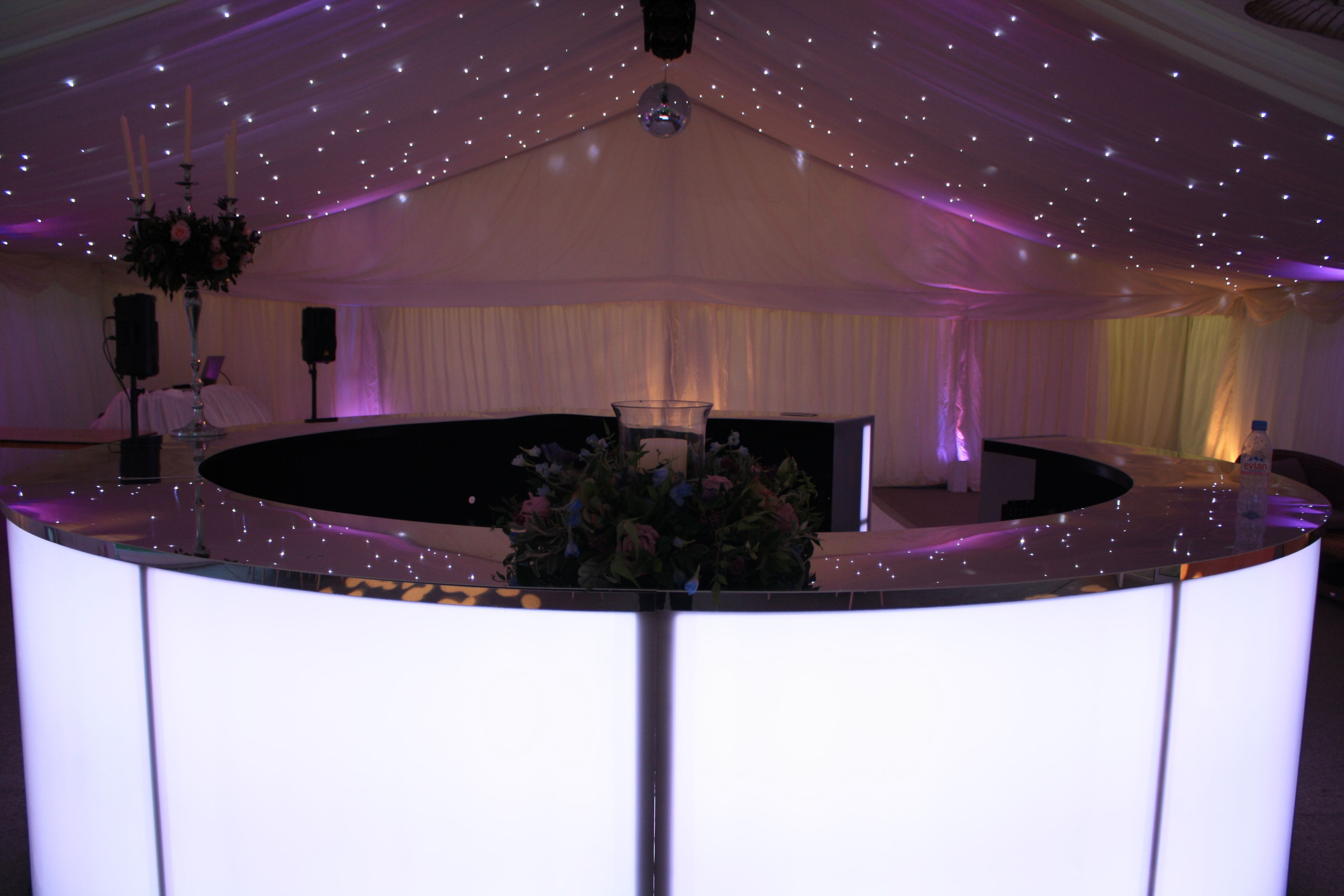 setting a beautiful scene in a frame marquee led lit circular led bar white star cloth white dance floor and beautiful results