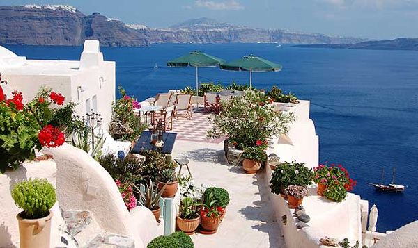 I can just imagine eating breakfast here....Santorini, Greece