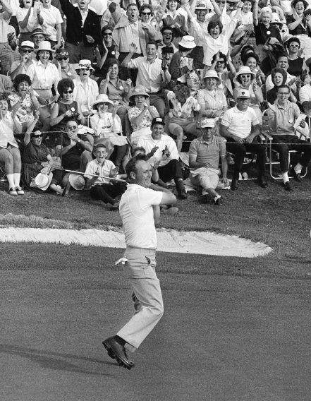 Palmer reacts to sinking a putt on the 72nd hole to win the 1964 Master.