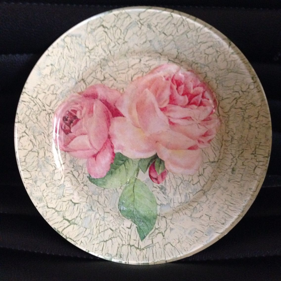 Decoupage on glass dinner plate with crackle finishing.