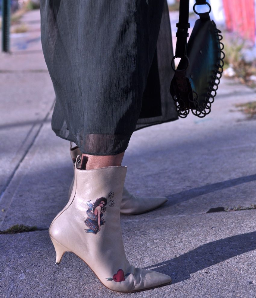 white ankle boots with tattoo design