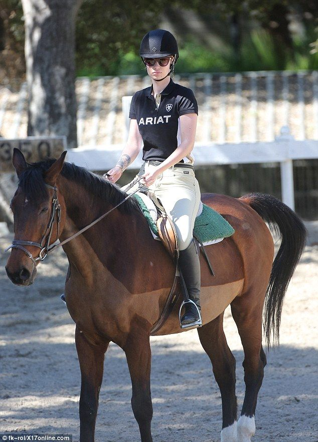 Aussie Rapper Horses Around At Stables In Knee High Riding