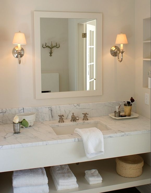 sconces, marble countertops, faucet, shelving, traditional yet modern lines