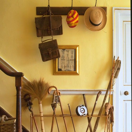 Entrance: the hallway, like the kitchen, has muted, mellow yellow ...