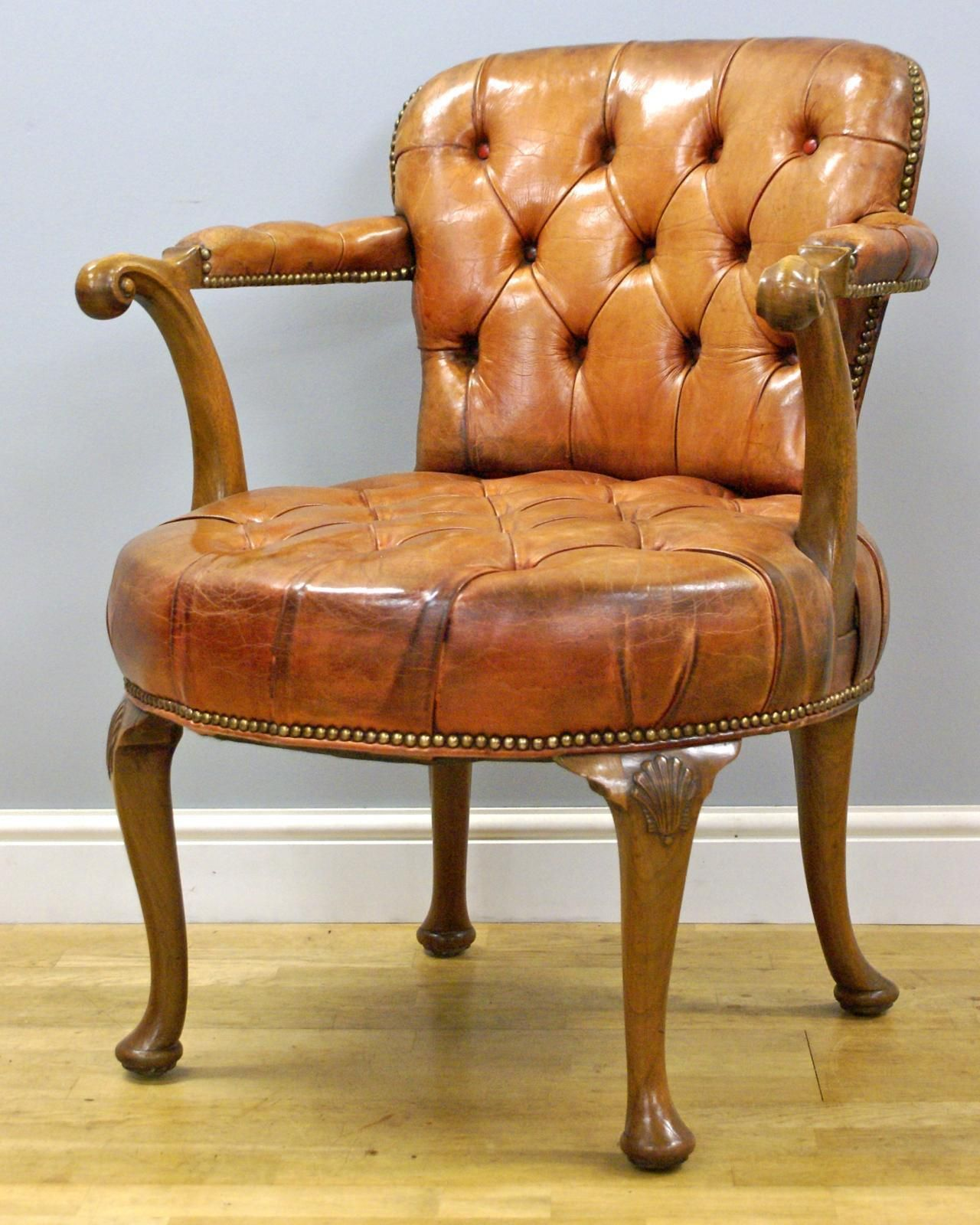 A Queen Anne style walnut and leather desk chair Looking For