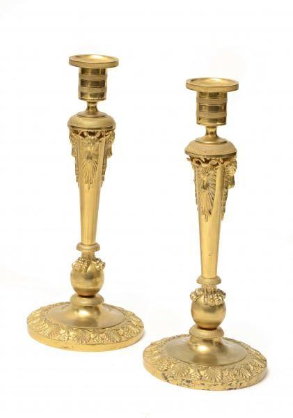 A pair of Restoration Era chiseled and gilt-bronze candlesticks.
