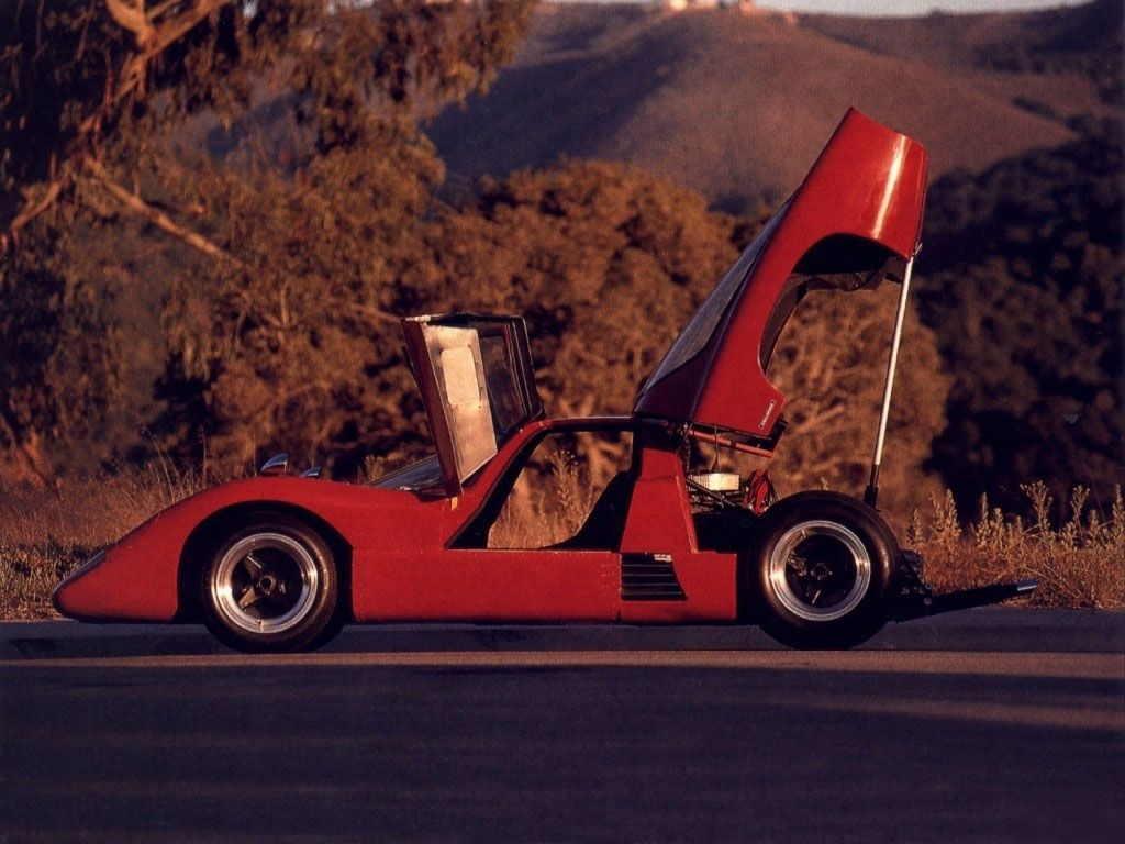 """McLaren M6GT.  Basically a coupe body on the McLaren M6 Can Am car, meant for endurance racing, it was instead used by Bruce McLaren as a road car for the last six months of his life.  A 1600Lb. car with an Al Bartz tuned Chevrolet 350 """"small block"""" V8, it offered scintillating performance for the day.  It also had headlamps that had to be raised by hand, from outside the car.  Still, by some estimates, McLaren's amazing road car heritage, starts here."""