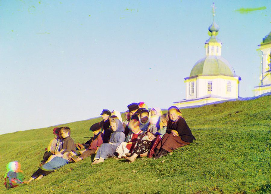 """Russia - circa. 1912  Photographed using an RGB filter that allowed later development in almost true colour.  """"Children sitting near a church on White Lake"""""""