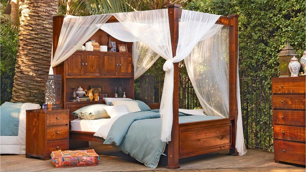 a nice combination of solid wood design and frill with the fabric perhaps lighter colored four poster bedsdream