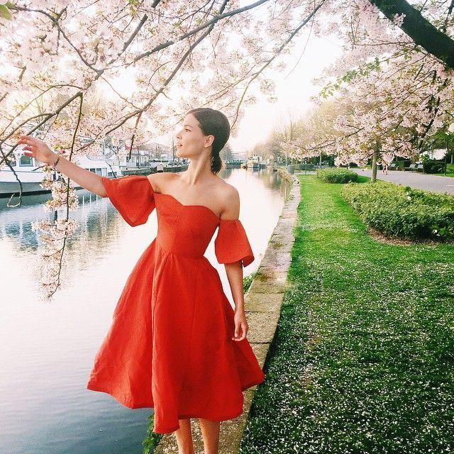 Shop Spring Party Dresses Spotted on Instagram - Hanneli Mustaparta (@hannelim) wearing an off-the-shoulder red silk midi dress by Vika Gazinskaya | Styloko