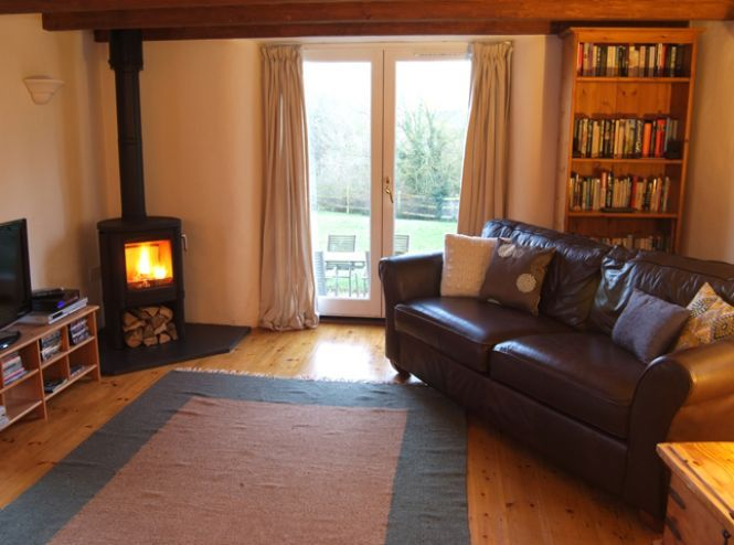 Small Wood Burner In Kitchen Snug Area Interior And