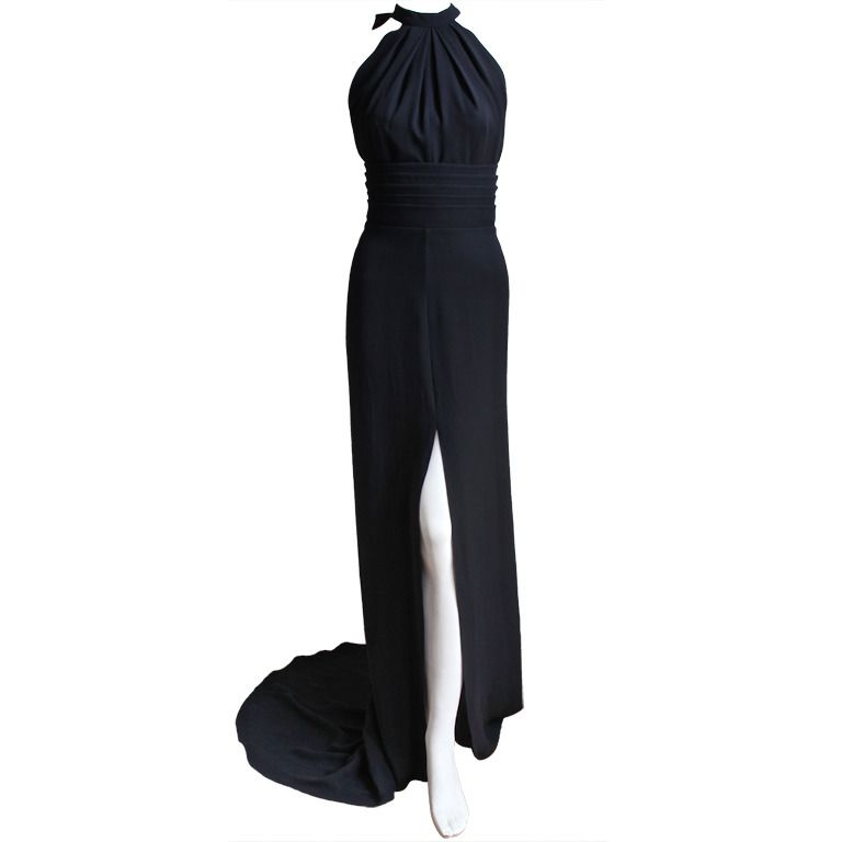 YVES SAINT LAURENT edition soir black silk evening gown with unique back | From a collection of rare vintage evening dresses at https://www.1stdibs.com/fashion/clothing/evening-dresses/