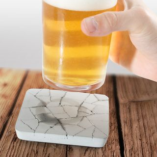 Water Absorbing Concrete Coaster at Firebox.com,  £11.99