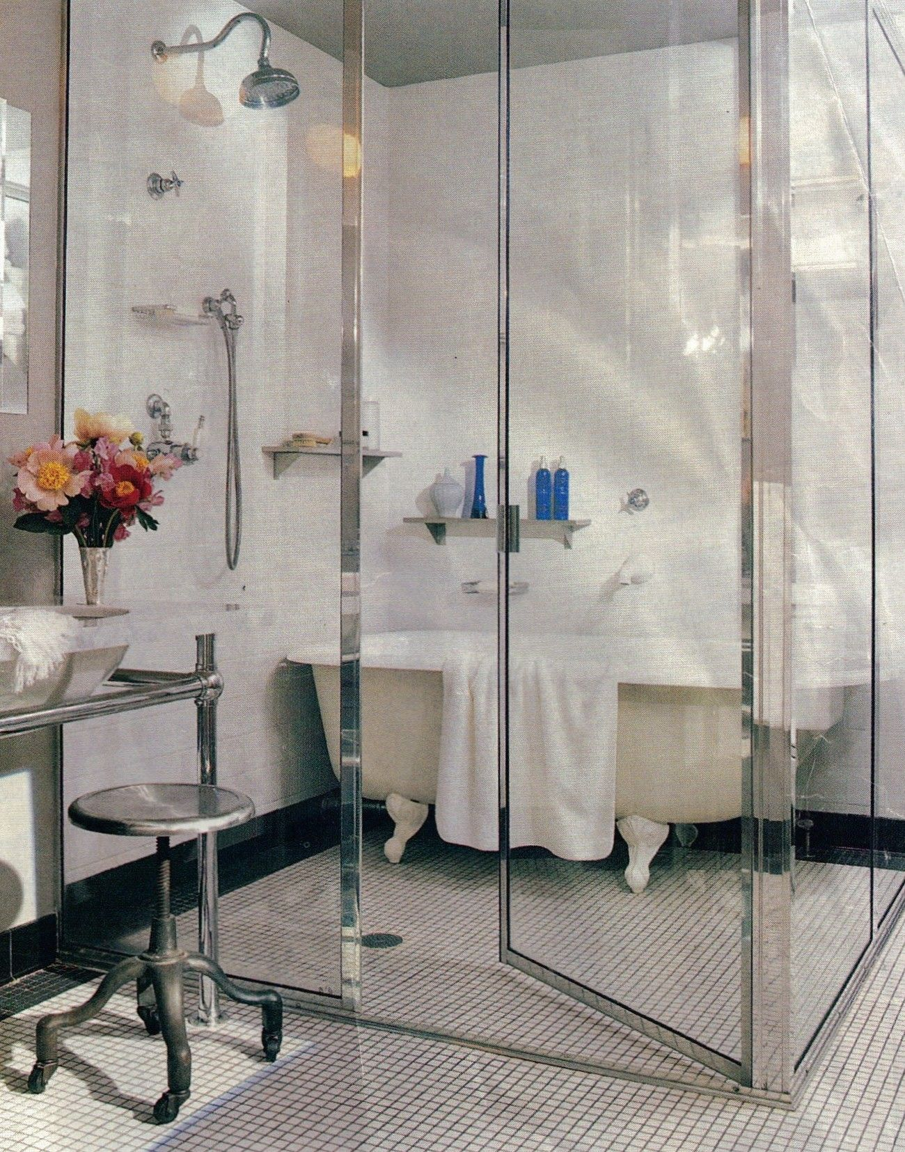 room within a room...floor to ceiling glass surround spacious shower ...