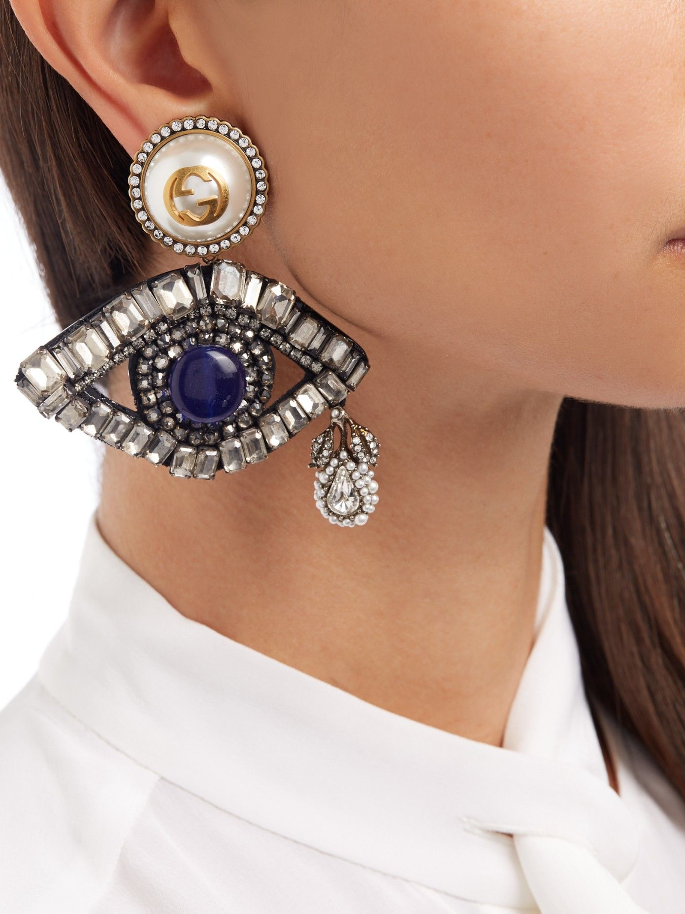 bab74b8c80d Gucci continues its maximalist mood this season with these evil  eye-inspired earrings. Wear hair to the side to show them off fully.