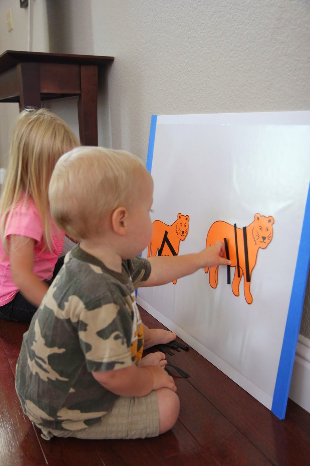 Toddler Approved!: Sticky Tiger Craft for Kids- just clear contact paper over tiger cutouts (they have a printable template)