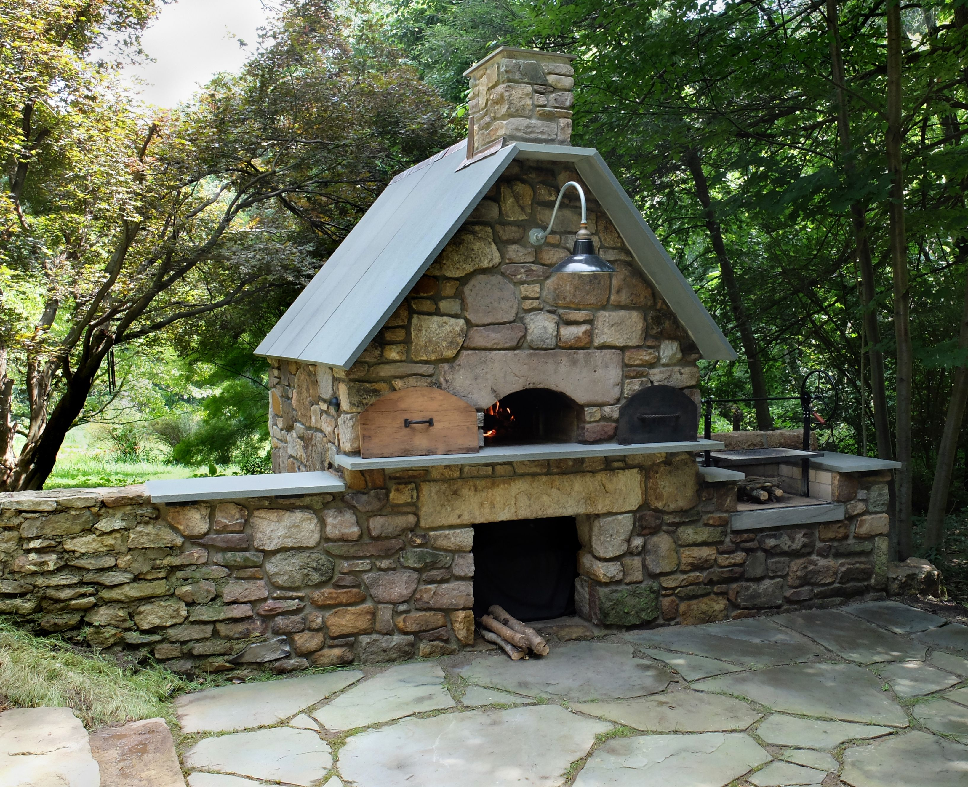 Outdoor woodfired pizza oven and barbecue designed and built by