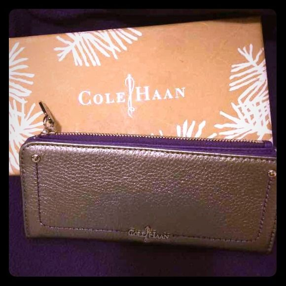 Cole Haan Wallet❌SOLD❌ Beautiful purple and silver metallic wallet. Never used .. Outside is silver inside is purple with zipper compartment and card slots .... Cole Haan Bags Wallets