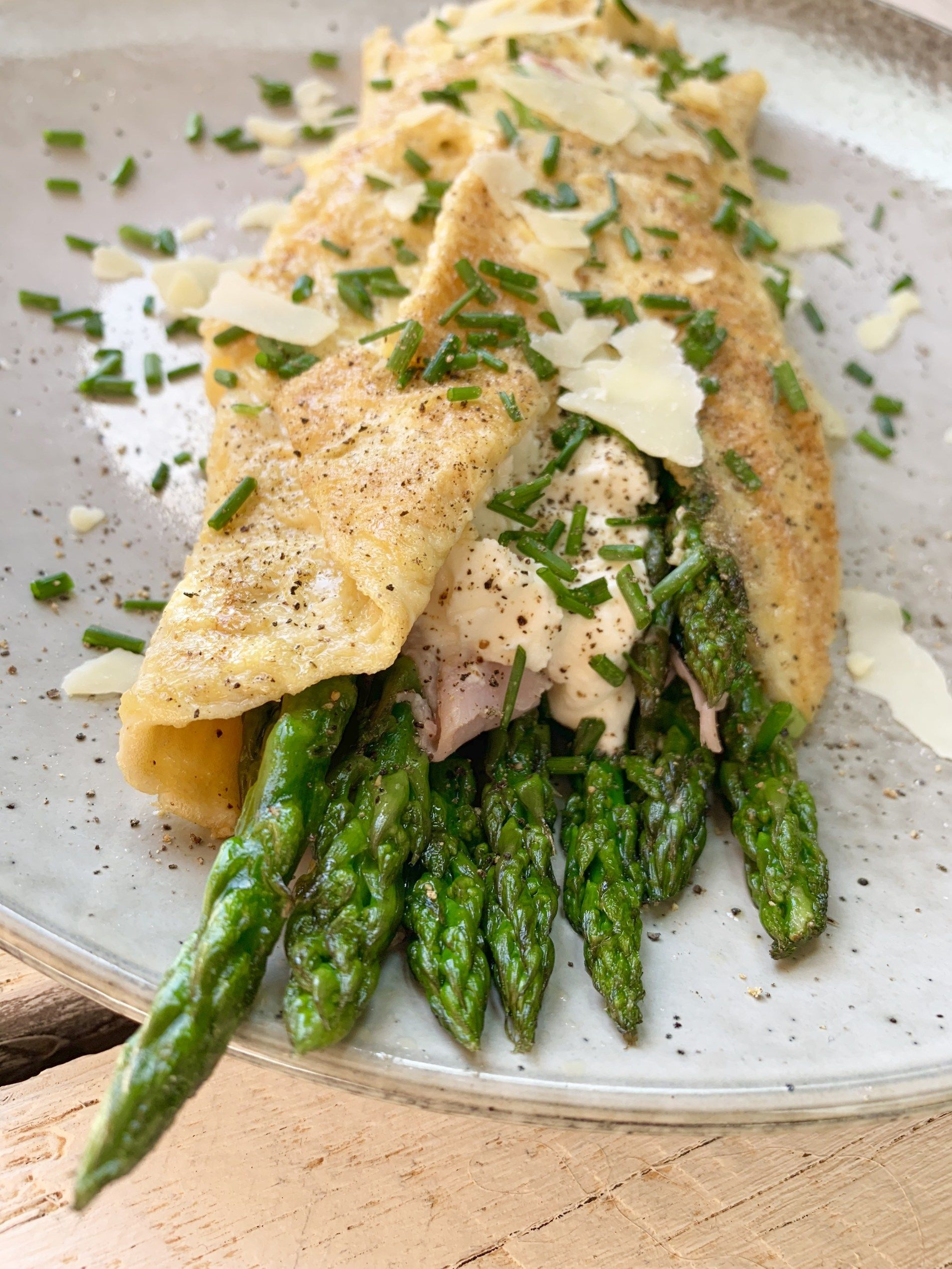 Eat asparagus smoked ham and ricotta cheese omelette