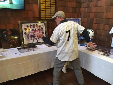 Caring for Children. Helped raise money with a college buddy of mine last night at a private country club in Jackson NJ. Such a Great group of dedicated people, I was happy to help with a silent & live auction.   Shown is 1 of the members checking out the sports memorabilia.  #charityfundraising   #charitygolfouting   #caringforchildren