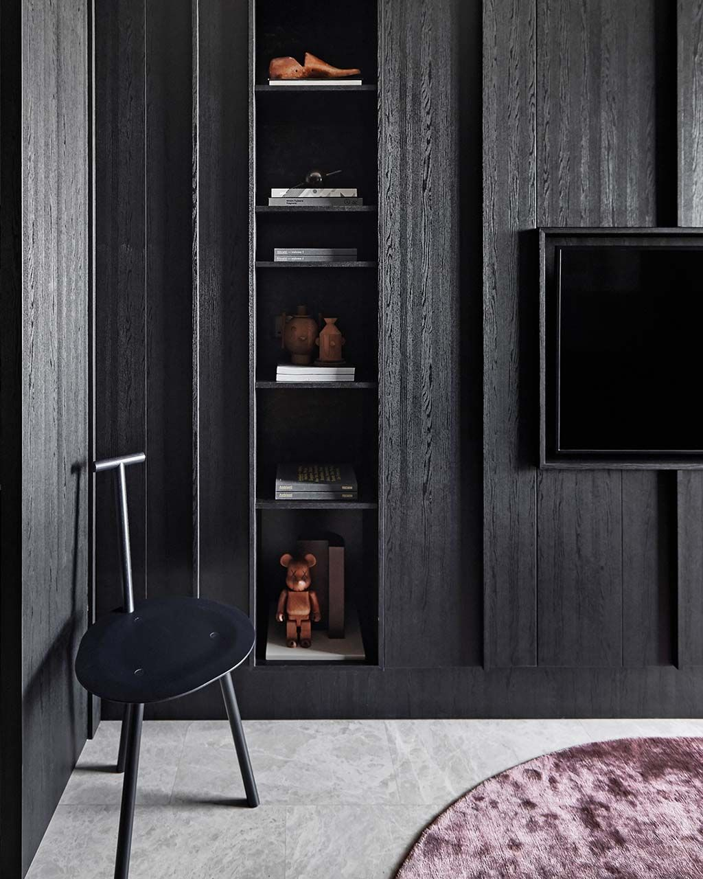 House Tour: A dark-hued apartment with artsy touches and