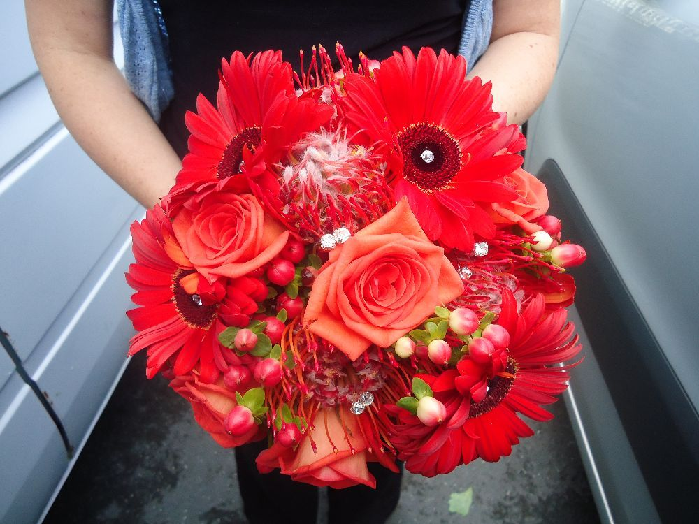 Beautiful vibrant reds and organges make a striking bridal bouquet for your wedding day. If you would like us to ceate this bouquet or would like to discuss your #wedding flowers with us, please give us a call on 0161 861 0524 and we'll be happy to help!