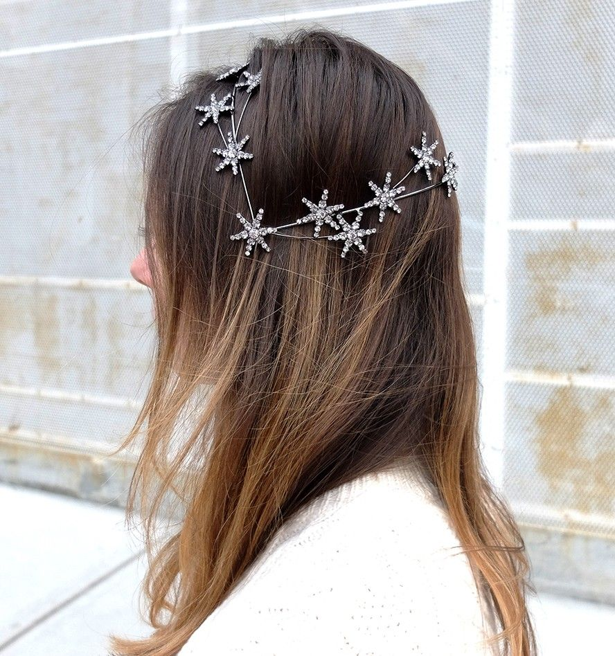Our signature coronet creates a comfortable base for you to wear the universe. The Celestial Coronet makes a stunning constellation of hand set Swarovski crystal stars. Sparkle all day and night in this original headpiece. Handmade in NYC. $1,125.00