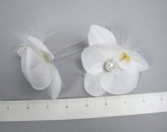 Cute white flower bridal hair clip with crystal center  Approx. flower 6 diameter .  Please feel free to ask me any questions or special requests. I have many other clips available. I have designed & created each piece in my shop All pieces are securely wrapped & boxed to prevent damage/breakage  FREE USA SHIPPING on orders of $200 or more!  Thank you very much for shopping at my shop Have a great day