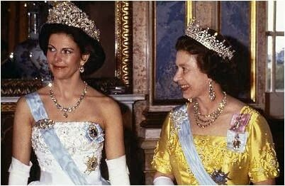 Super powered bling: two queens, bringing out their best. Silvia is wearing the massive Braganza Tiara; Elizabeth is wearing her favorite Gir...