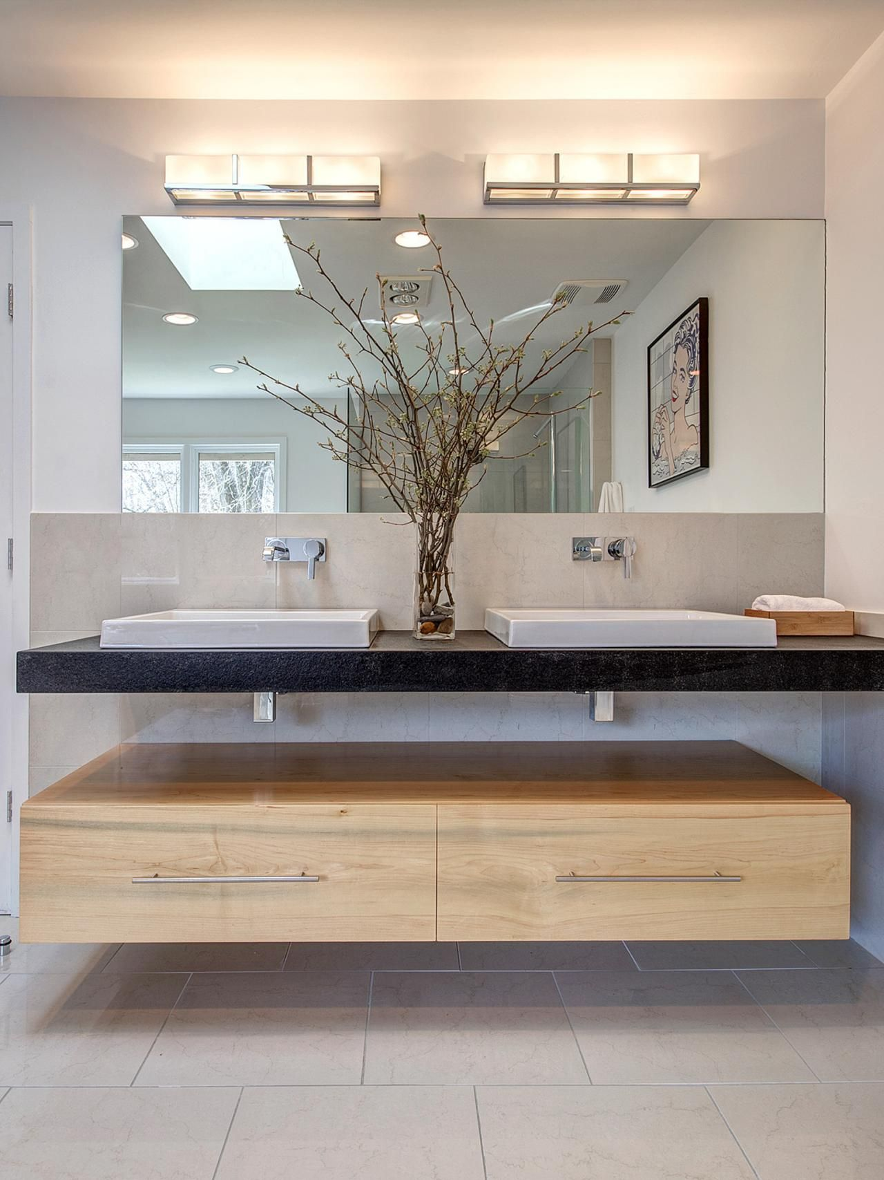 A double sink is mirrored on top and bottom with - Contemporary double sink bathroom vanity ...